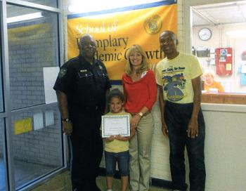 Bryanne Davis of M.E. Norman Elementary School was recently honored by school faculty as student of the month for September. From left, Earl Johnson, St. Mary Parish deputy/mentor; Davis; Shannon Hoffpauir, M.E. Norman Elementary School principal; and Herman Hartman, mentor.