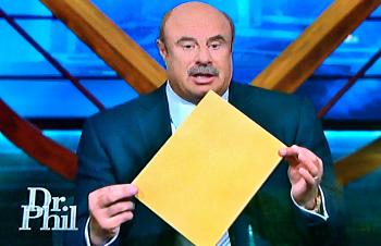 """Family members of the late Glenn Lemoine appeared on the """"Dr. Phil"""" show Tuesday. Dr. Phil McGraw holds up the results of a polygraph test."""