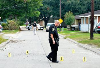 Morgan City police place evidence markers next to bullet casings this morning at Federal Avenue and Orange Street. A black male in a white Lexus was wounded at Lawrence Street and Levee Road. Multiple shots were reported at about 10 a.m. A lockdown at Maitland Elementary, Norman Elementary, Central Catholic High and Holy Cross Elementary schools were lifted by noon. Superintendent Donald Aguillard said he had been told the shooter was believed to be in the area, possibly in a nearby house.