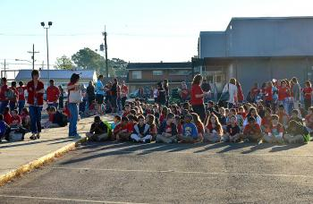 Wyandotte Elmentary School students wait to be evacuated to Morgan City Junior High School after a gas leak.