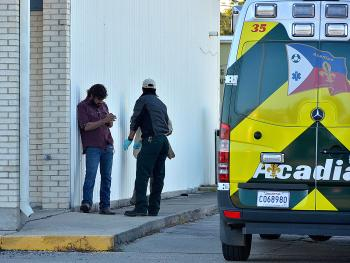 Acadian Ambulance of Morgan City tends to a plant worker who may have injured his hand this morning after a gas line leaked in the areas of Grizzaffi Street and Railroad Avenue.
