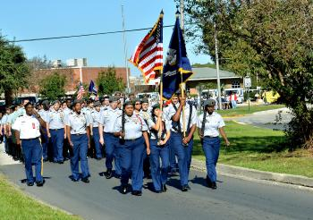 Junior ROTC members lead the Red Ribbon Parade of Schools Saturday on Victor II Boulevard in Morgan City.
