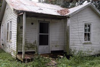 The house at 6 Darce Lane has sat vacant since the night in February 2010 when its residents Audrey Picard, 75, and Larry Guillory, 49, were brutally murdered. The trial of suspect Jamichael Lashawn Hudson, 18, is ongoing in 16th Judicial District Court.
