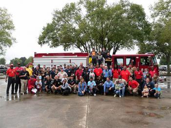 Participants in Saturday's Red Ribbon Week motorcade through St. Mary Parish stopped at the School Board office in Centerville for lunch and a group photo. Red Ribbon Week continues through Sunday.