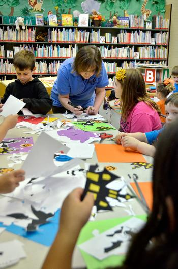 """Gathering to cut out and color """"Halloween Silhouette's"""" were, left photo from left, Daniel Vasquez, library clerk Trish Dupre, Peyton Skiles, Eli Dupuis, and Katie Walicky."""