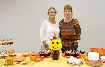 """Crystal Marcel and Nancy Marcel, from left respectively, were hostesses for Bayou Vista Garden Club's October meeting. Marcel created the floral design titled, """"Good Witch of the South,"""" in keeping with the Halloween theme."""