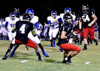 Patterson wide receiver Rene Maillet prepares to head upfield after making a reception during the Lumberjacks' Week 2 contest against East Ascension. Maillet and the rest of the Lumberjacks will hit the road Friday when they travel to face Southern Lab in a 7 p.m. contest.
