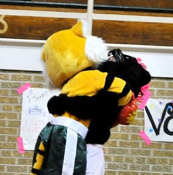 Morgan City Junior High School held its Pink Game earlier this month. Prior to the game, the school held a ceremony in which various groups from the school and Berwick Junior High School participated. Above, Morgan City Junior High School and Berwick Junior High School mascots hug after each performed to music. Berwick Junior High won the seventh-grade match, while Morgan City took the eight-grade match.
