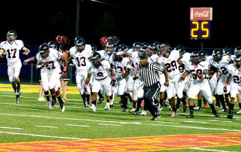 The Patterson Lumberjacks run toward their sideline  prior to their contest with Southern Lab last week. After starting the season 0-2, Patterson has won four straight, including last week's 51-24 victory. Patterson will look to extend its winning streak when it travels to Donaldsonville to open District 9-3A play Friday.