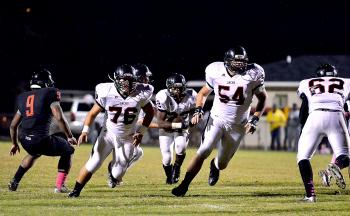 Patterson's Jayce LeBlanc, Landon Thomas and Malik Garrett block for Tristen Ausuma during the Lumberjacks' game against Donaldsonville last week. Patterson will renew its district rivalry with E.D. White when the two teams meet Friday in Thibodaux.
