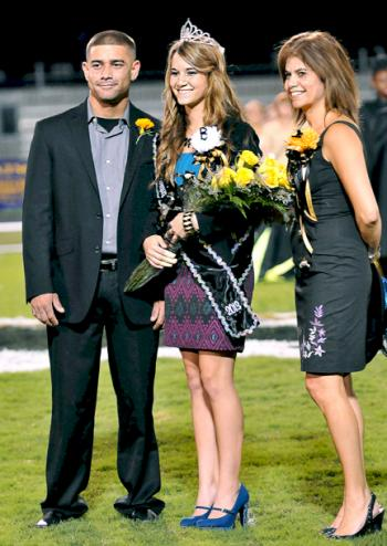Berwick High School Homecoming Queen Sara Swisher, center, is escorted by her brother, Stephen Swisher III and her mother, Cindy Businelle, during the homecoming game Friday.