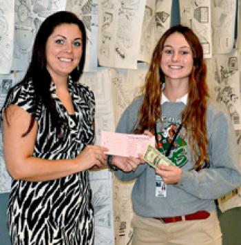 """From left, Morgan City High School teacher Tori Grizzaffi buys a raffle ticket for """"Paint the Pit Pink"""" from enior volleyball player Marilynn Bailey."""