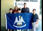 The American Legion Post 242 donated a new Louisiana state flag to Morgan City's M.E. Norman Elementary School Color Guard, front, from left, Ashton Money, Ben Lewis and Joseph Daigle. Back, from left, Lisa Hampton, M.E. Norman teacher, and Troy Larive, American Legion Post 242 representative.