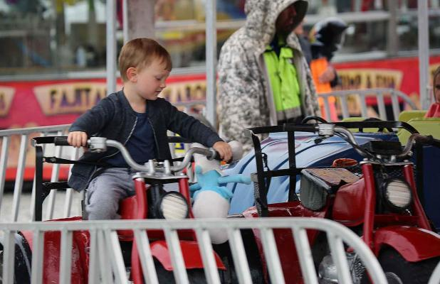 66b36d5e04 A youngster enjoys a midway motorcycle ride during the 2018 Cypress Sawmill  Festival. (The Daily Review Bill Decker)